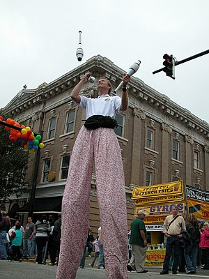 Juggling - Street juggler Mark Lippard on stilts at the Lexington Barbecue Festival.