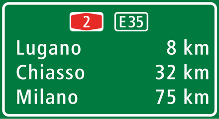 ASTRA-Frutiger, a condensed variant of Frutiger, on a road sign near Lugano in Switzerland in 2011 Loc.-Lugano.PNG