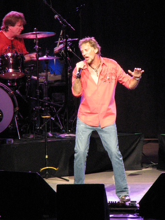"American singer Kenny Loggins is known as the ""King of the Movie Soundtrack"" for his contribution to movies. Loggins Interlochen.png"