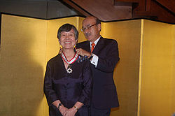Lydia Yu-Jose being conferred the Order of the Rising Sun.jpg