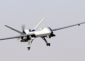 A MQ-9 Reaper unmanned aerial vehicle prepares...