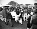 Mahatma Gandhi is carried from his main house to the Garden area after breaking a five-day fast in New Delhi.jpg