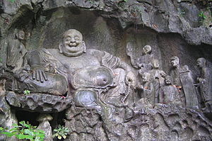 Maitreya and disciples carving in Feilai Feng Caves
