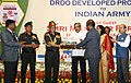 Manohar Parrikar handing over a replica of Weapon Locating Radar (WLR), Swathi to the Chief of Army Staff, General Bipin Rawat, at the handing over ceremony of the DRDO developed products to the Indian Army, in New Delhi.jpg