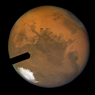 History of Mars observation - Hubble's sharpest view of Mars: Although the ACS fastie finger intrudes it achieved a spatial scale of 5 miles, or 8 kilometres per pixel at full resolution.