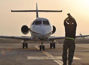 Expeditionary Air Wing - Visiting Aircraft Section (VASS) from 901 Expeditionary Air Wing marshalling a No. 32 Squadron RAF BAe 125 aircraft in the Middle East.