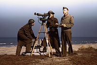 Men of Fort Story operate an azimuth instrument, to measure the angle of splash in sea-target practice.jpg