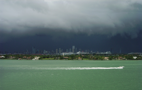 Summer afternoon showers from the Everglades traveling eastward over Downtown Miami