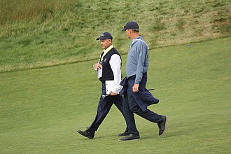 United States Golf Association - Mike Davis (on left), current executive director of the USGA, walking down the 18th fairway at the 2018 U.S. Open.