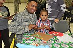 Military members, families enjoy Holiday party 161202-F-WF462-050.jpg