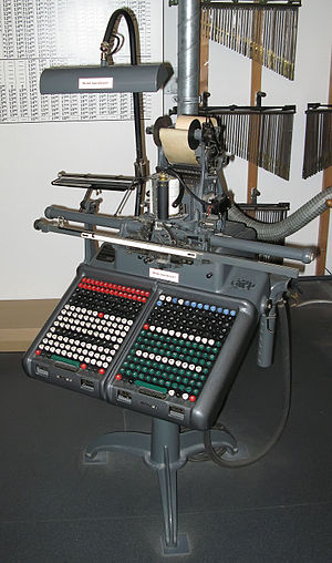 Monotype System - A Monotype keyboard; the tape reel being produced is at the top
