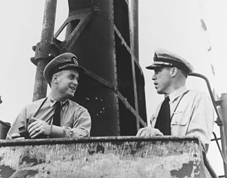 Richard O'Kane - O'Kane speaks with his commanding officer, Dudley Morton, on the bridge of the Wahoo c. February 1943