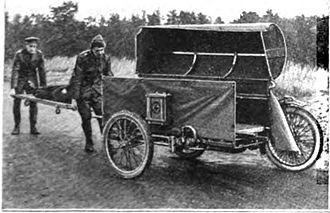 Motorcycle ambulance - Demonstration of loading wounded soldiers into motorcycle ambulance. 1918.