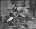 Mrs Hammond, American Red Cross, serving water to badly wounded British soldier on platform of railroad station at... - NARA - 530728.tif