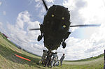 Multinational soldiers learn sling load operations 130713-A-XD724-947.jpg