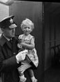 National Eisteddfod of Wales, Ebbw Vale, 1958 - A policeman with a lost child (4859623321).jpg