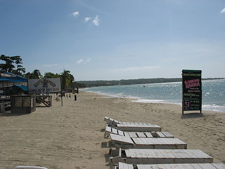 A beach in Negril with a hotel and restaurant Negril-Beach.jpg