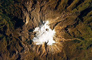 Armero tragedy - Nevado del Ruiz seen from space. The summit ice cap and glaciers surround the dark Arenas crater.