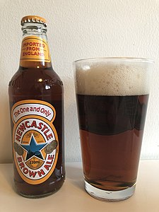 Newcastle Brown Ale poured in pint glass.jpg