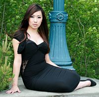 Nice full length shot of Lucy sitting by a lamp post.jpg