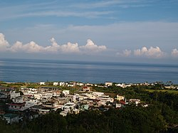 Ningpu Village, with the Pacific Ocean in the background