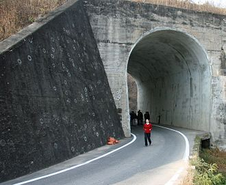 No Gun Ri massacre - This 2008 photo shows a concrete abutment outside the No Gun Ri bridge, where investigators' white paint identifies bullet marks and embedded fragments from U.S. Army gunfire in the 1950 shooting of South Korean refugees.
