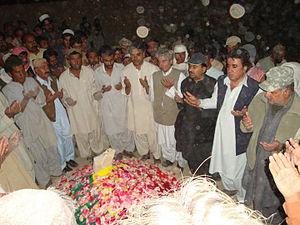 Mir Nooruddin Mengal -  Mourners praying for Mir Nooruddin Mengal at his grave in Kalat.