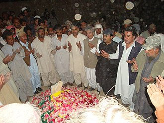 Mir Nooruddin Mengal -  Mourners praying for Mir Nooruddin Mengal at his grave in Kalat.