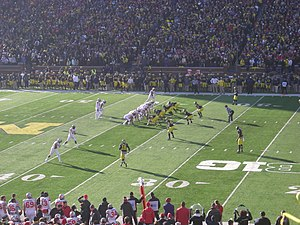2013 Ohio State Buckeyes football team - Ohio State lines up on offense near midfield.