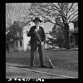 Old Mennonite sweeping leaves8d23488v.jpg