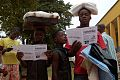 Oxfam East Africa - Children read cholera-prevention leaflets.jpg