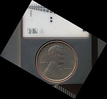 Penny united states coin wikipedia 1909 vdb us lincoln penny on the planet mars part of a calibration target on the curiosity rover september 10 2012 3 d version also publicscrutiny Images