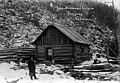 Packer Jack Newman in front of his cabin, Skagway, 1898 (AL+CA 5).jpg