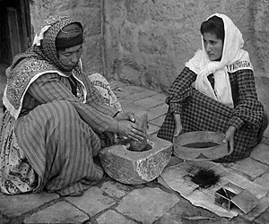 1905 Stereoscope. Original caption reads: The native mode of grinding coffee, Palestine.