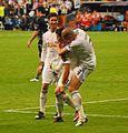 Pepe tirando al suelo a Cristiano Ronaldo tras el gol (5593118433).jpg