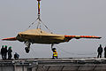 Personnel load a U.S. Navy X-47B Unmanned Combat Air System demonstrator aircraft onto the flight deck of the aircraft carrier USS George H.W. Bush (CVN 77) in Norfolk, Va., May 6, 2013 130506-N-CZ979-057.jpg