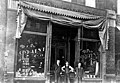 Peter Kolloen and two others in front of Star Paint and Wallpaper Company, Seattle, probably between 1901 and 1905 (SEATTLE 49).jpg