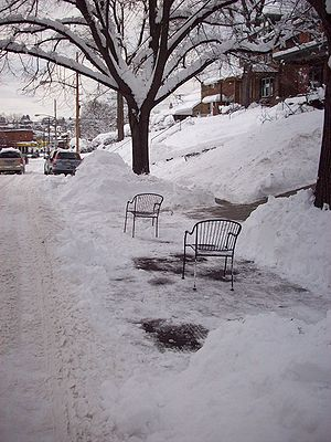 Parking chair - Two patio chairs reserving a shoveled-out street parking space in Pittsburgh's Squirrel Hill neighborhood