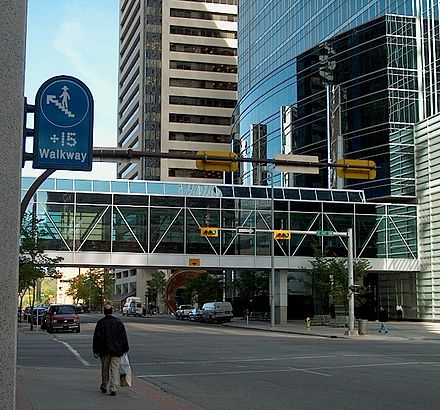 Calgary's +15 skyway network is one of the world's most extensive pedestrian skywalk systems. Plus 15 sign and walkway Calgary.jpg