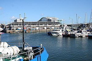 Sutton Harbour - View of the National Marine Aquarium and Plymouth Fisheries across Sutton Harbour.