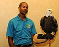 Posing for picture with Bald Eagle. (10595035886).jpg