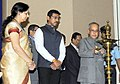 Pranab Mukherjee lighting the lamp at the National Press Day celebrations, in New Delhi on November 16, 2015. The Minister of State for Information & Broadcasting, Col. Rajyavardhan Singh Rathore is also seen.jpg