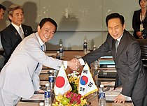 President Lee meeting with Japanese Prime Minister Taro Aso in Thailand April 2009.jpg