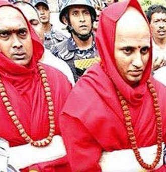 Pashupatinath Temple - Raghavendra Bhat (right) and Girish Bhatt in traditional 4-5 kg heavy Priestly garb of Pashupatinath Temple