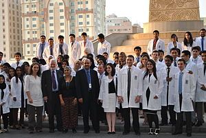 White coat ceremony - RCSI Bahrain students taking a group photo following the 2013 White coat ceremony