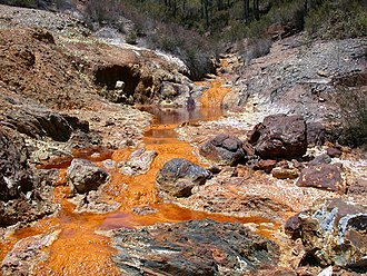 Rio Tinto (corporation) - The company's name comes from the Rio Tinto in southwestern Spain, which has flowed red since mining began there about 5000 years ago, due to acid mine drainage