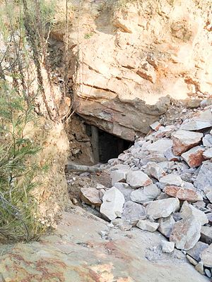 Artisanal mining - This is an adit (horizontal or sloping mine entrance) in the Johannesburg municipality, near the suburb of Roodeport. It is part of a chain of similar adits along a surface outcrop of the Roodeport gold reef of the Witwatersrand, South Africa.