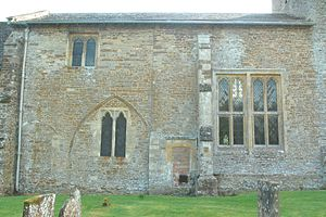 Rousham - North wall of the nave of SS Leonard and James', showing large 16th-century window and blocked arch to former 14th-century chantry chapel