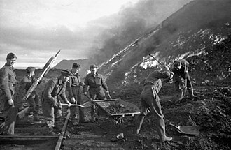 Operation Gauntlet - Sappers of the 3rd Field Company, Royal Canadian Engineers, burning coal piles during Operation Gauntlet (taken by Ross Munro)