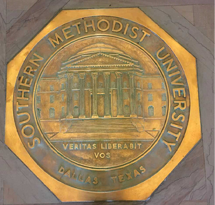 SMU seal in floor of Dallas Hall. Campus lore holds that if students step on it, they will not graduate on time. SMU seal.png